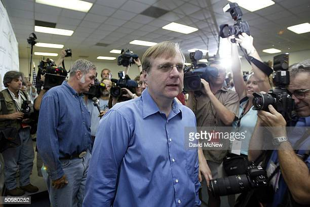 Microsoft cofounder Paul Allen and aerospace engineer Burt Rutan exit a media conference on the eve of the first nongovernmental flight to leave the...
