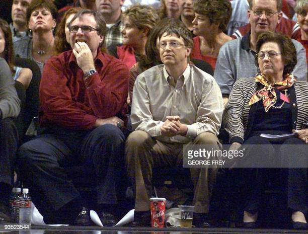 Microsoft co-founders Bill Gates and Paul Allen watches the third game of the Western Conference Finals between the Los Angeles Lakers and the...