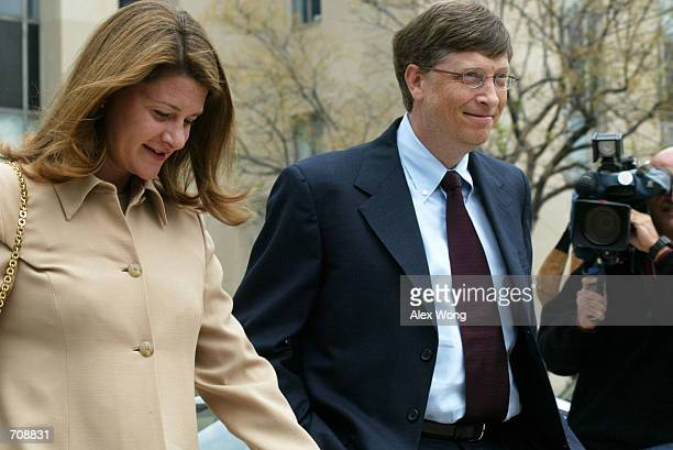 Microsoft Corp Chairman Bill Gates arrives at US District Court with his wife Melinda April 22 2002 in Washington DC Gates is taking the witness...