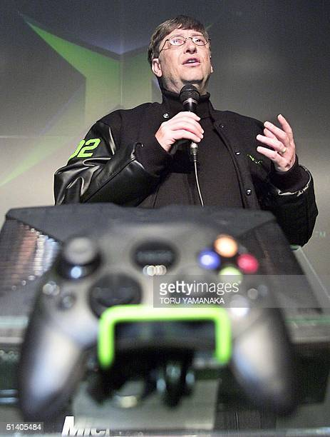 Microsoft Corp. Chairman Bill Gates introduces its Xbox home video game console during a press conference at Shibuya shopping district in Tokyo 21...