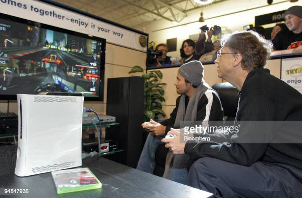 Microsoft Corp. Chairman Bill Gates, right, plays a game against Isaias Formacio on the Xbox 360 video-game console in the final hour before they...