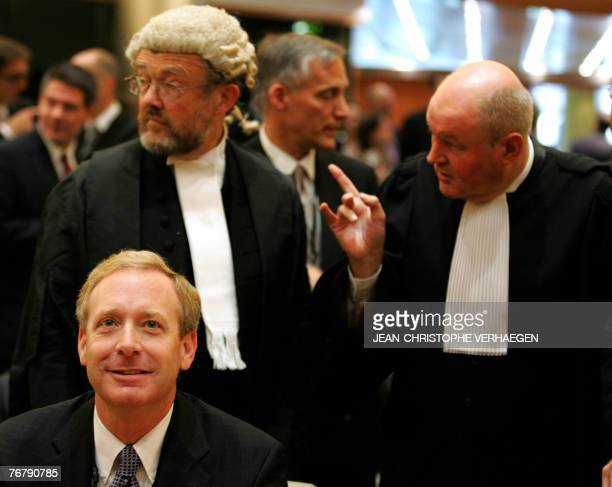 Microsoft Corp legal chief Brad Smith waits 17 September 2007 with Microsoft lawyers Ian Forrester and JeanFrancois Bellis for the start of a...