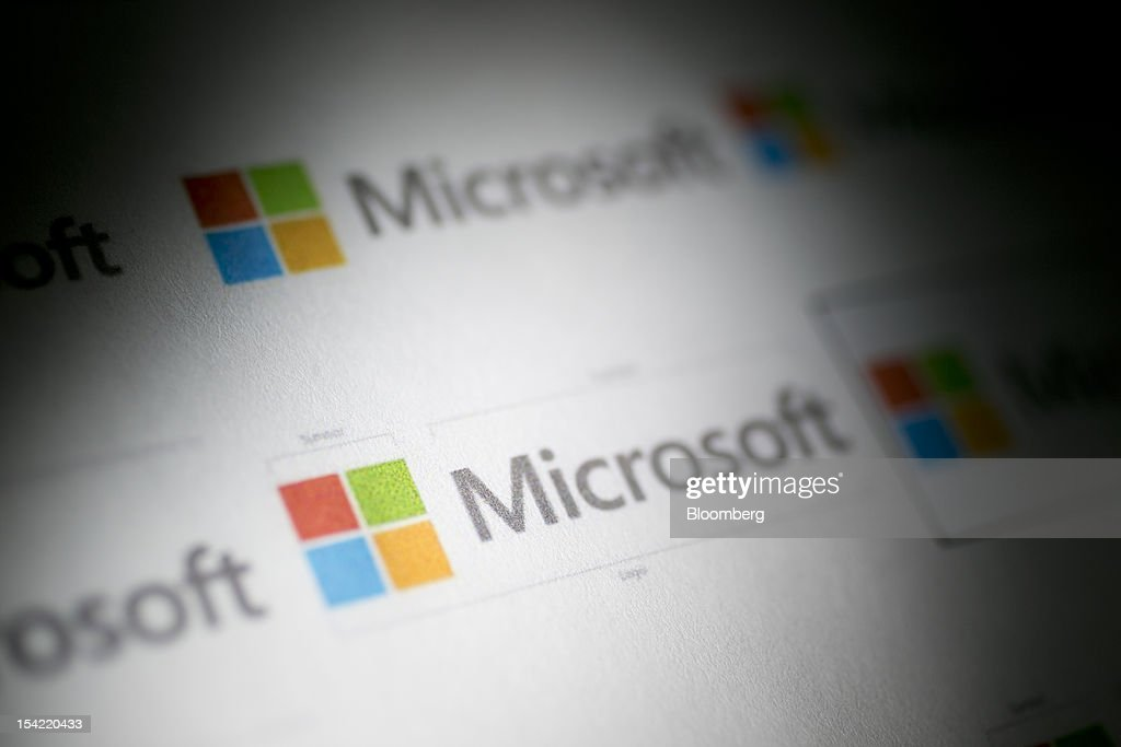 Microsoft Corp. logos are displayed for a photograph in Washington, D.C., U.S., on Monday, Oct. 15, 2012. Microsoft Corp. is scheduled to release earnings data on Oct. 18. Photographer: Andrew Harrer/Bloomberg via Getty Images