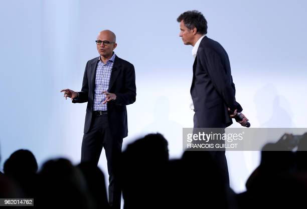 Microsoft Corporation chief executive Satya Nadella speaks as Publicis Group chairman Arthur Sadoun listens during the presentation of the digital...