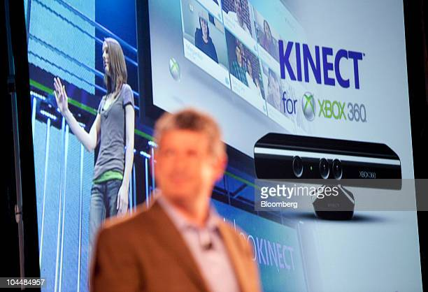 Microsoft Corp's Kinect motion controller for the Xbox 360 gaming console is displayed on screen as Darren Huston corporate vice president of global...