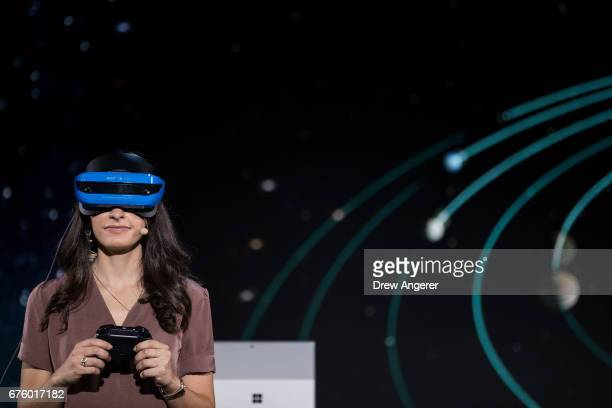 Microsoft employee demonstrates a Acer Windows VR headset during a Microsoft launch event May 2 2017 in New York City The Windows 10 S operating...