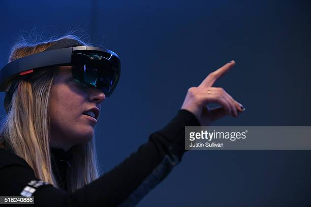 Microsoft employee Gillian Pennington demonstrates the Microsoft HoloLens augmented reality viewer during the 2016 Microsoft Build Developer...