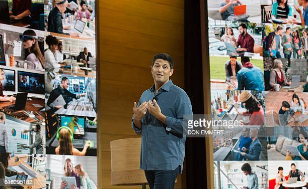 Microsoft executive Terry Myerson speaks at a Microsoft news conference to unveil updated versions of its the Surface Book and the Surface Pro 4...