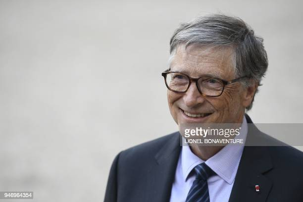 Microsoft founder and billionaire philanthropist Bill Gates leaves the Elysee presidential palace after a meeting with French President on April 16...