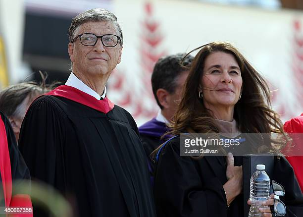 Microsoft founder and chairman Bill Gates and his wife Melinda attend the 123rd Stanford commencement ceremony June 15 2014 in Stanford California...