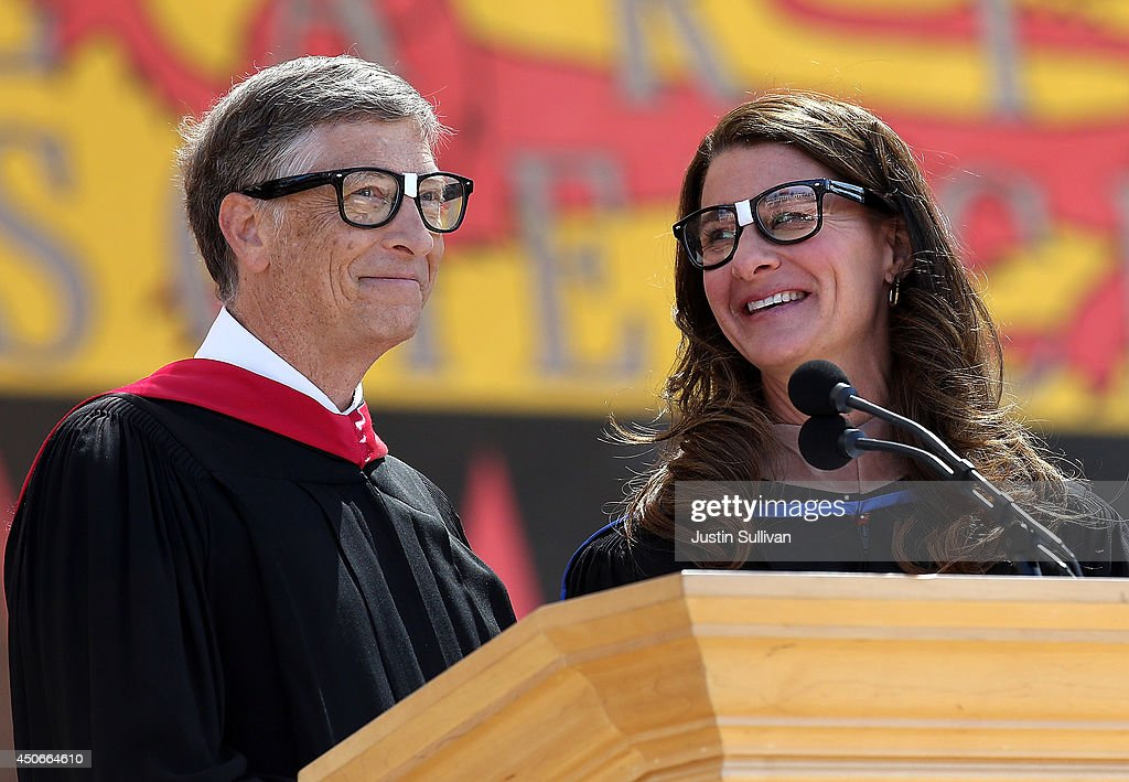 Microsoft founder and chairman Bill Gates shares the stage with his wife Melinda during the 123rd Stanford commencement ceremony June 15, 2014 in Stanford, California. Bill Gates and wife Melinda Gates delivered the commencement speech to Stanford University graduates.
