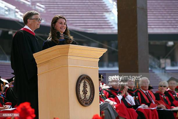Microsoft founder and chairman Bill Gates shares the stage with his wife Melinda during the 123rd Stanford commencement ceremony June 15 2014 in...