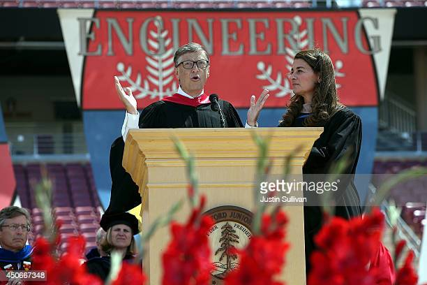Microsoft founder and chairman Bill Gates speaks as his wife Melinda looks on during the 123rd Stanford commencement ceremony June 15 2014 in...