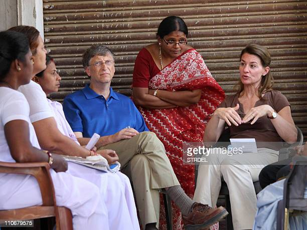 Microsoft founder and philanthopist Bill Gates and his wife Melinda talk to local villagers during a visit to Jamsaut villages at Patna district in...