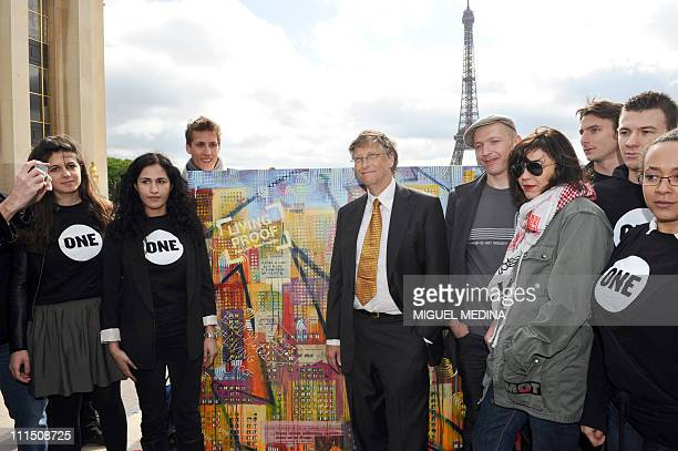 Microsoft founder and philanthropist Bill Gates poses in front of a painting of two artists Dag and Russian Artof Popof on April 4 2011 at the...