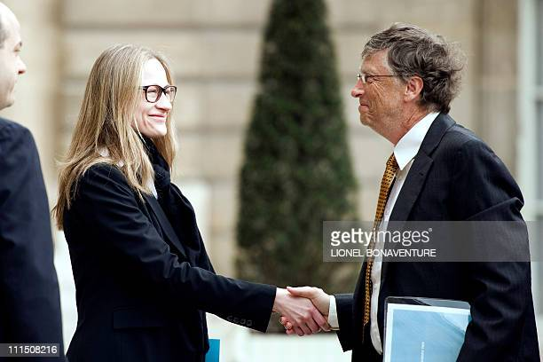 Microsoft founder and philanthropist Bill Gates shakes hands with Consuelo Remmert, half sister of Carla Bruni-Sarkozy as he leaves the Elysee...