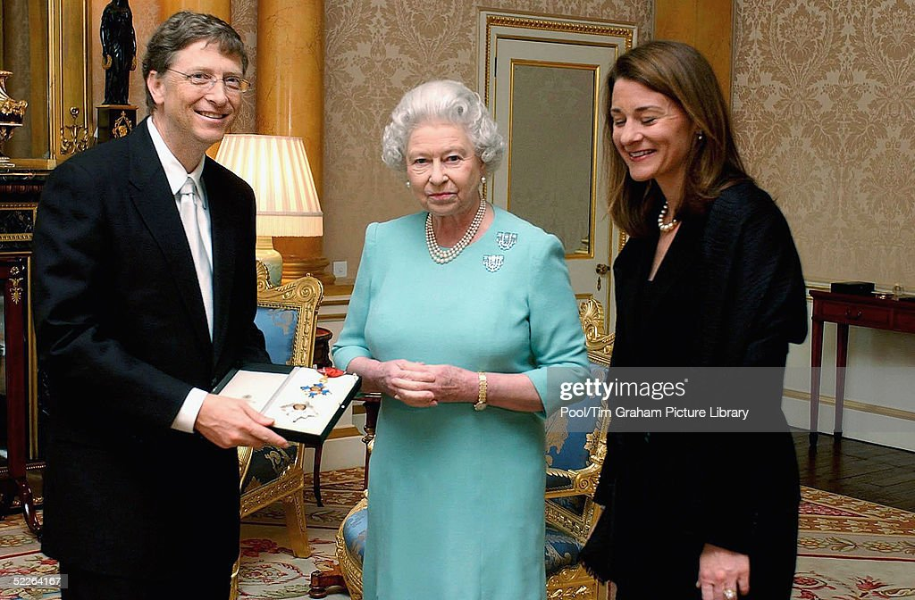 HRH Microsoft founder Bill Gates and his wife Melinda pose for photographs after Gates is awarded an honorary knighthood at Buckingham Palace on March 2, 2005 in London, England. Mr Gates received a Knighthood from Queen Elizabeth II in recognition of his outstanding contribution to enterprise, employment, education and the voluntary sector in the UK, and his contributions to poverty reduction .