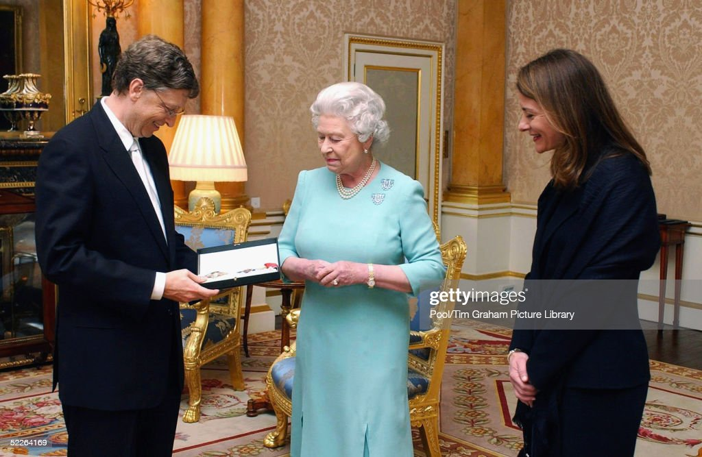 Microsoft founder Bill Gates and his wife Melinda pose for photographer after Gates is awarded an honorary knighthood at Buckingham Palace on March 2, 2005 in London, England. Mr Gates received a Knighthood from Queen Elizabeth II in recognition of his outstanding contribution to enterprise, employment, education and the voluntary sector in the UK, and his contributions to poverty reduction .