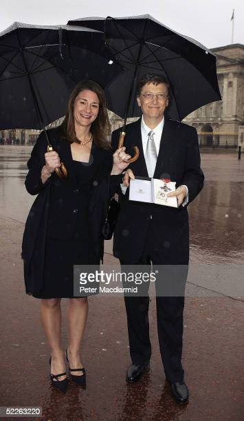 Microsoft founder Bill Gates and his wife Melinda pose for photographers outside Buckingham Palace, March 2, 2005 in London, England. Mr Gates...