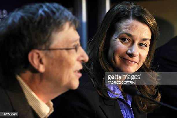 Microsoft founder Bill Gates and his wife Melinda smile during a press conference on their Bill Melinda Gates Foundation on the third day of the...