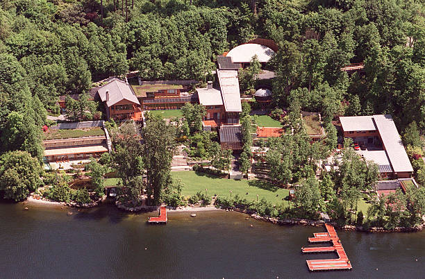 Microsoft founder Bill Gates'' home lines the banks of Lake Washington, May 30, 2001 in Seattle, Washington. Despite 37,000 square feet of living...
