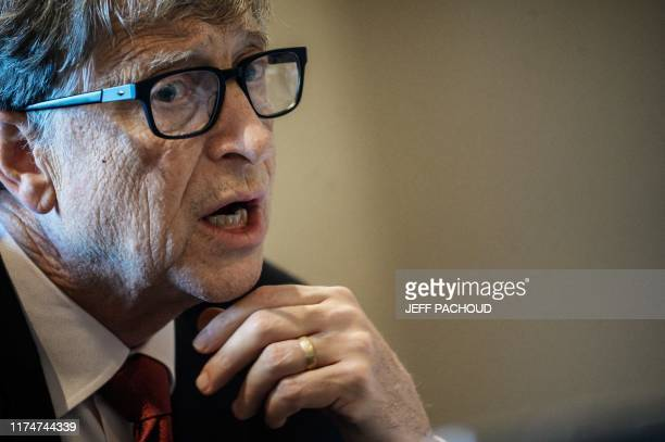 Microsoft founder, Co-Chairman of the Bill & Melinda Gates Foundation, Bill Gates, takes part in a conference call on October 9 in Lyon, central...