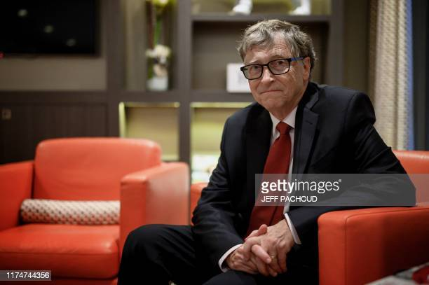 US Microsoft founder CoChairman of the Bill Melinda Gates Foundation Bill Gates poses for a picture on October 9 in Lyon central eastern France...