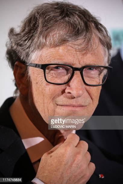 Microsoft founder CoChairman of the Bill Melinda Gates Foundation Bill Gates poses during a photocall at the start of the funding conference of...