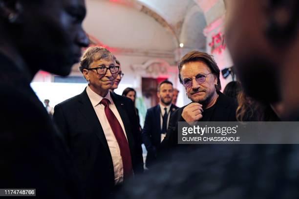 Microsoft founder, Co-Chairman of the Bill & Melinda Gates Foundation, Bill Gates and Irish rock band U2 singer Bono arrive at Lyon's city hall,...