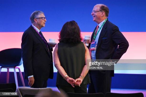 Microsoft founder-turned-philanthropist Bill Gates chats with Larry Fink, chairperson of BlackRock, during the Global Investment Summit at the...