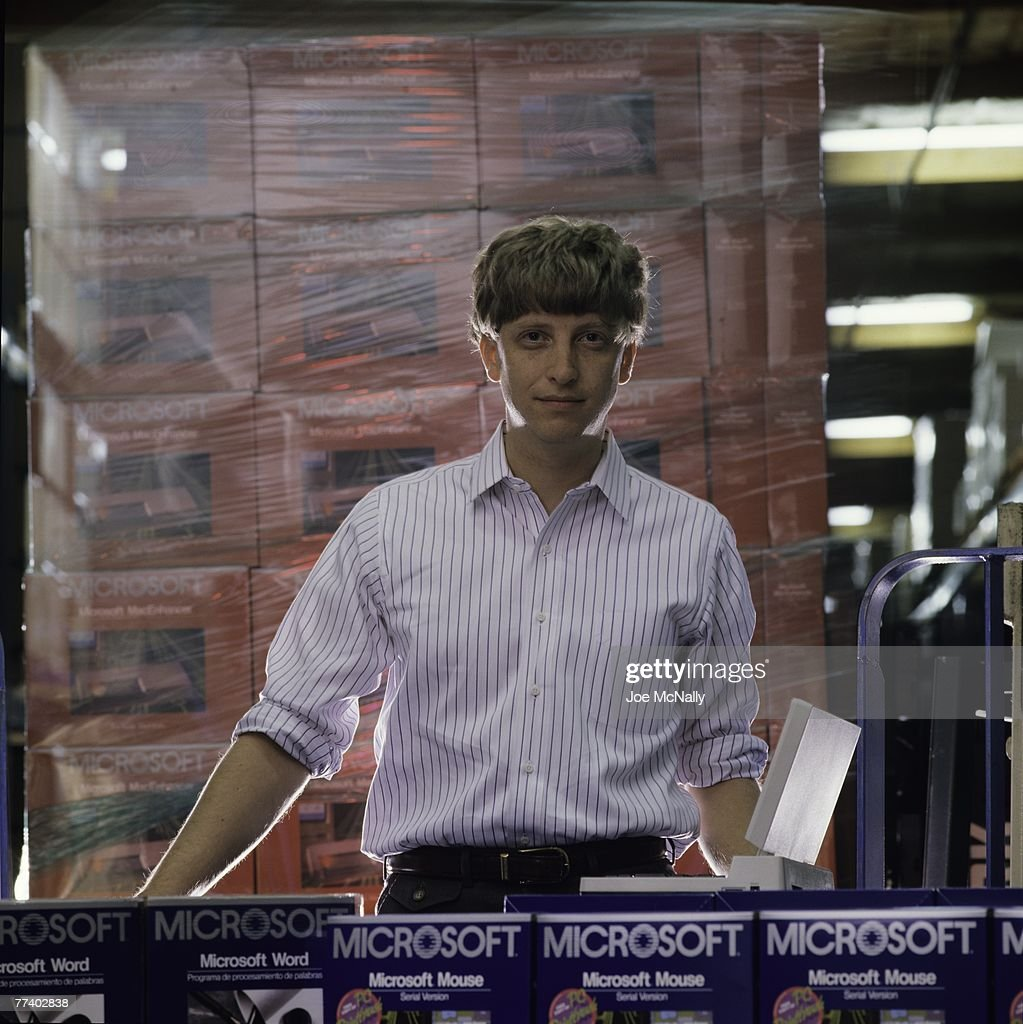 Microsoft owner and founder Bill Gates poses in front of boxes of Microsoft products in 1986 at the packaging facility in the new 40-acre corpororate campus in Redmond, Washington. In March, Microsoft held an initial public offering of 2.5 million shares. By the end of the year, Gates became a billionaire at the age of 31. Microsoft was the first company to dominate the personal computer market with it's MS-DOS system and subsequently the Windows platform.