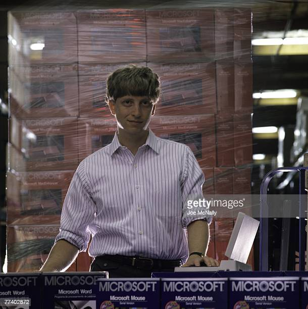 Microsoft owner and founder Bill Gates poses in front of boxes of Microsoft products in 1986 at the packaging facility in the new 40acre corpororate...