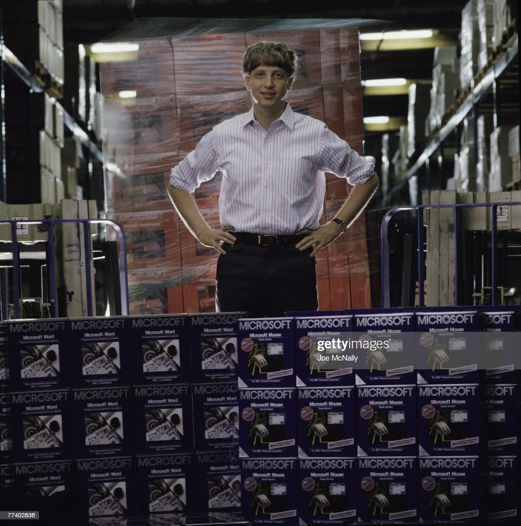 Microsoft owner and founder Bill Gates poses in front of hundreds of boxed Microsoft products in 1986 at the packaging facility in the new 40-acre corpororate campus in Redmond, Washington. In March, Microsoft held an initial public offering of 2.5 million shares. By the end of the year, Gates became a billionaire at the age of 31. Microsoft was the first company to dominate the personal computer market with it's MS-DOS system and subsequently the Windows platform.