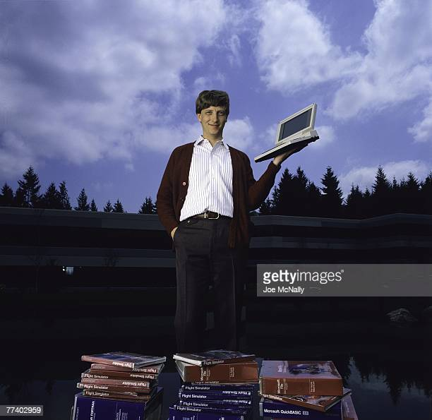 Microsoft owner and founder Bill Gates poses outdoors with Microsoft's first laptop in 1986 at the new 40-acre corpororate campus in Redmond,...