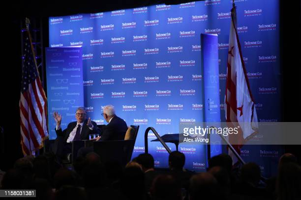 Microsoft principle founder Bill Gates participates in a discussion with President of the Economic Club of Washington David Rubenstein during a...