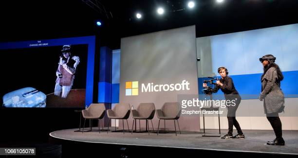 Microsoft Senior Product Marketing Manager Sohana Punithakumar demonstrates Microsoft HoloLens with a colleague during the Microsoft Annual...