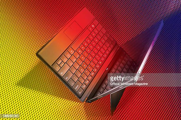 A Microsoft Surface Pro tablet PC with a keyboard photographed on a colourful mesh background taken on April 4 2013