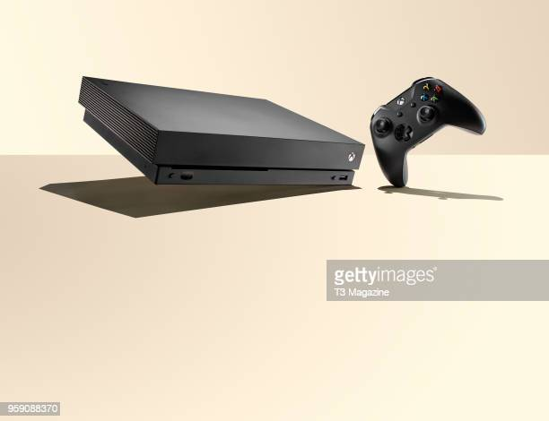 Microsoft Xbox One X home console and wireless controller, taken on October 24, 2017.
