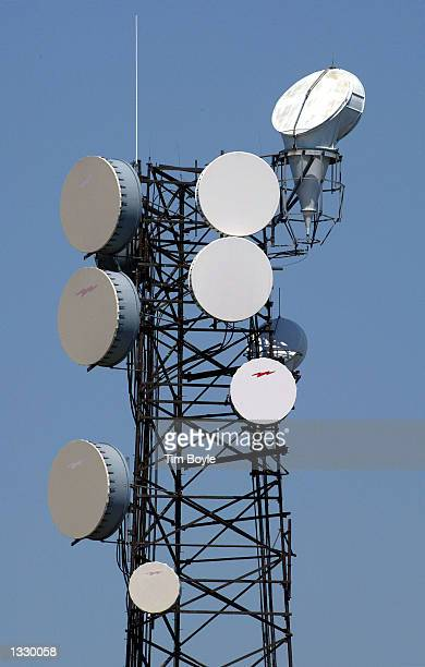 Microwave transmission/reception equipment is visible atop a tower at a WorldCom technical center August 9 2002 in Downers Grove Illinois Bankrupt...