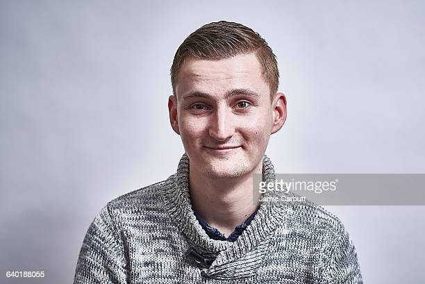 Mid 20's British male, smiling at camera
