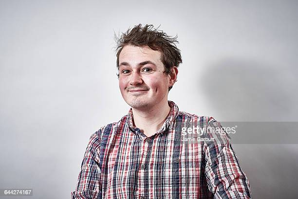 A mid 20's British male with a cheeky expression