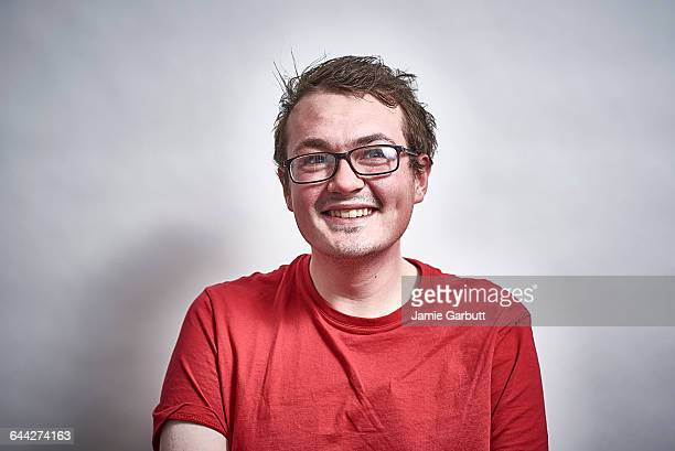 Mid 20's British male with glasses laughing