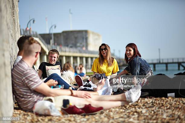 a mid 20's group of friends relaxing on the beach - portsmouth england stock pictures, royalty-free photos & images