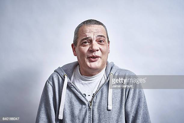Mid 40's British male talking to camera happily