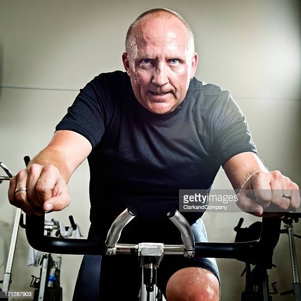 Mid 40's Man Taking a Spinning Class