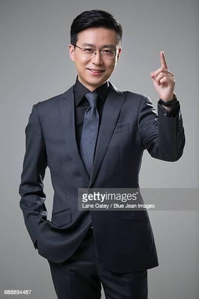 Mid adult businessman pointing