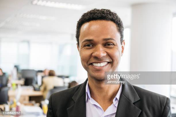 mid adult businessman smiling towards camera - pardo brazilian stock pictures, royalty-free photos & images
