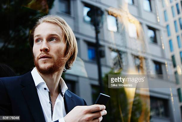 Mid adult businessman using smart phone