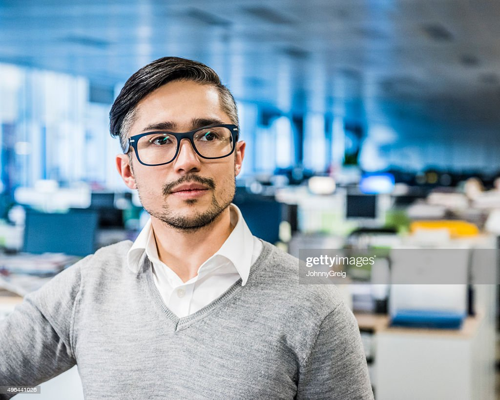 Mid adult businessman wearing glasses with beard, portrait : Stock Photo