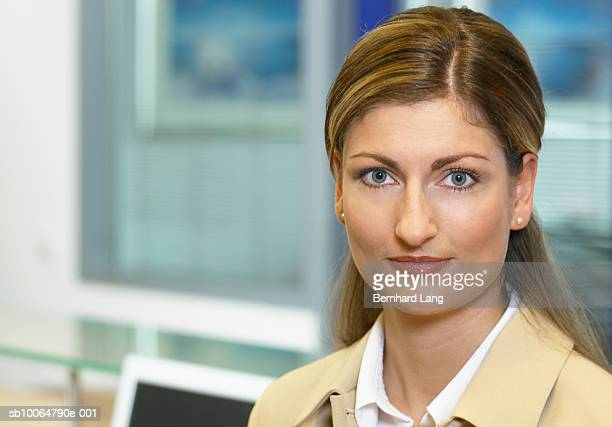 Mid adult businesswoman in office, portrait, close-up
